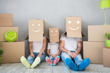 family with smiling boxes